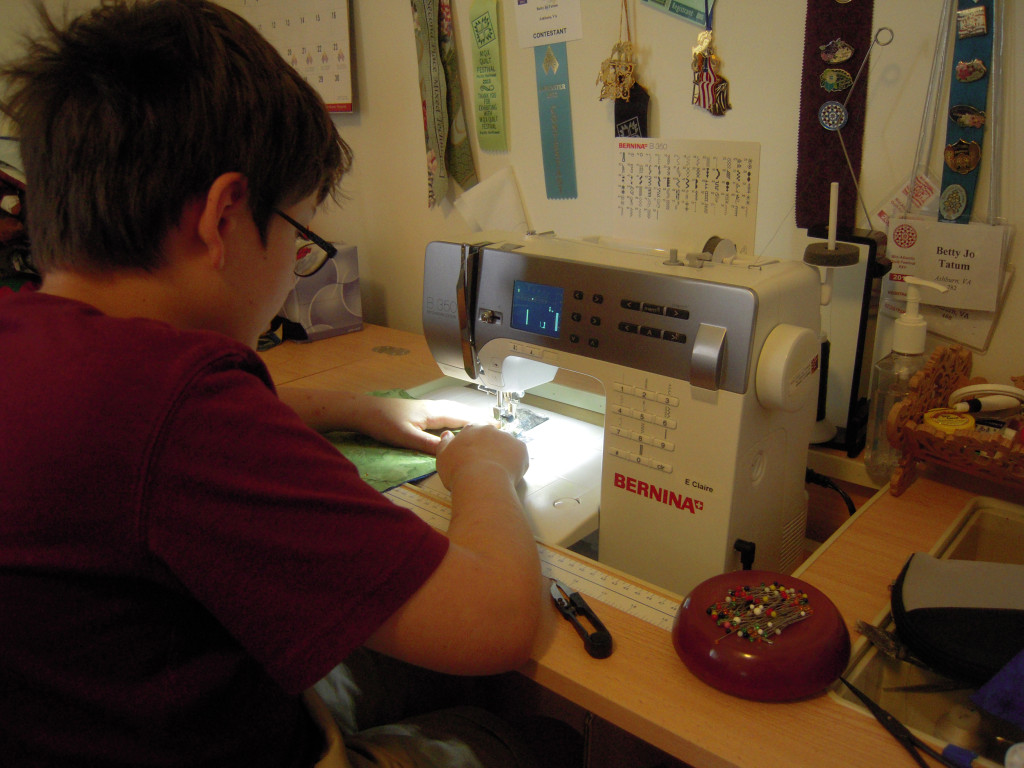 Kevin sewing in 2014