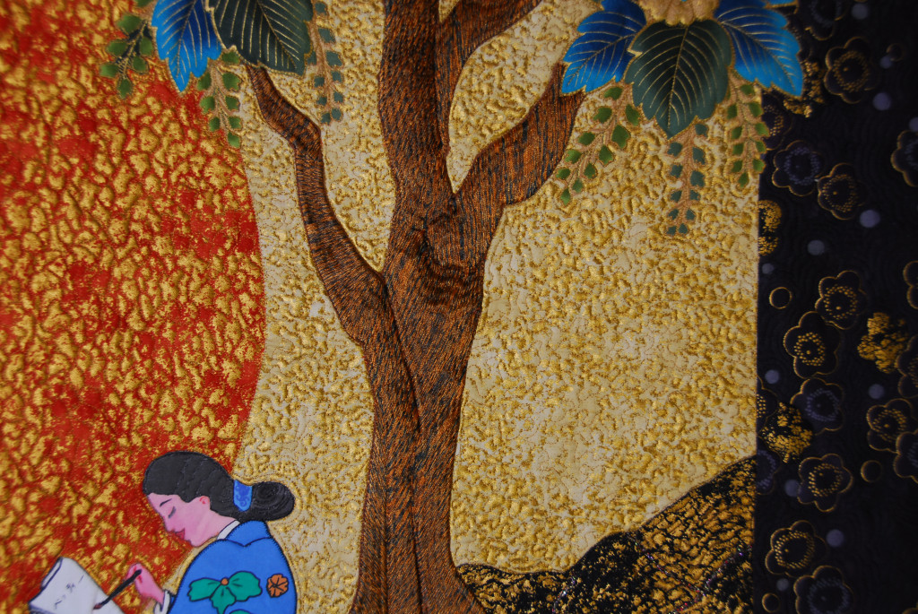 The tree was embroidered and then appliqued.